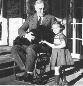 Picture of FDR in wheelchair with Polio